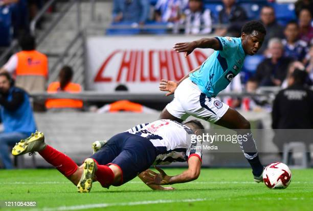 Cesar Montes of Monterrey fights for the ball with Anderson Julio of San Luis during the 9th round match between Monterrey and Atletico San Luis as...