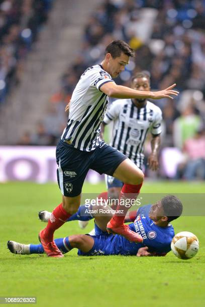 Cesar Montes of Monterrey fights for the ball with Angel Mena of Cruz Azul during the semifinal first leg match between Monterrey and Cruz Azul as...