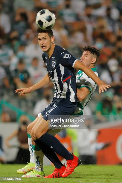 Cesar Montes of Monterrey fights for the ball with Jesus Ocejo of Santos during the 10th round match between Santos Laguna and Monterey as part of...