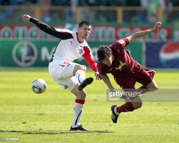 Cesar Navas of FC Rubin Kazan battles for the ball with Stevica Ristic of FC Amkar Perm during the Russian Football League Championship match between...