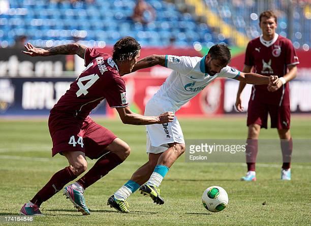 Cesar Navas of FC Rubin Kazan is challenged by Danny of FC Zenit St Petersburg during the Russian Premier League match between FC Rubin Kazan and FC...