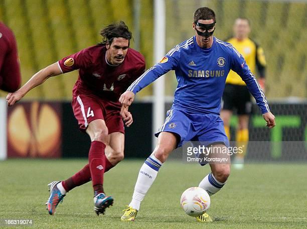 Cesar Navas of FC Rubin Kazan is challenged by Fernando Torres of Chelsea FC during the UEFA Europa League quarter final second leg match between FC...