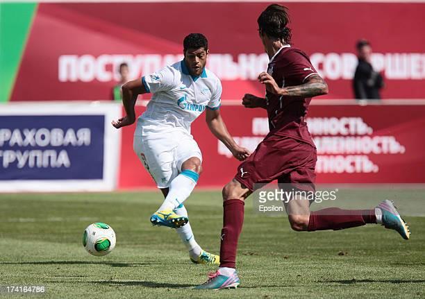 Cesar Navas of FC Rubin Kazan is challenged by Hulk of FC Zenit St Petersburg during the Russian Premier League match between FC Rubin Kazan and FC...