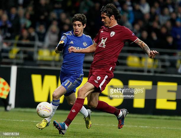 Cesar Navas of FC Rubin Kazan is challenged by Oscar of Chelsea FC during the UEFA Europa League quarter final second leg match between FC Rubin...