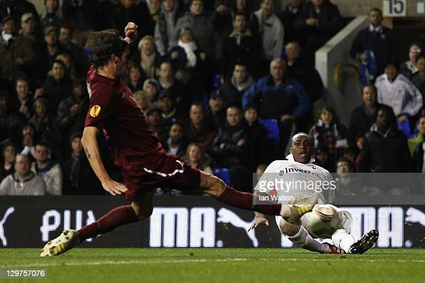 Cesar Navas of FC Rubin Kazan tackles Danny Rose of Tottenham Hotspur during the UEFA Europa League Group A match between Tottenham Hotspur and FC...