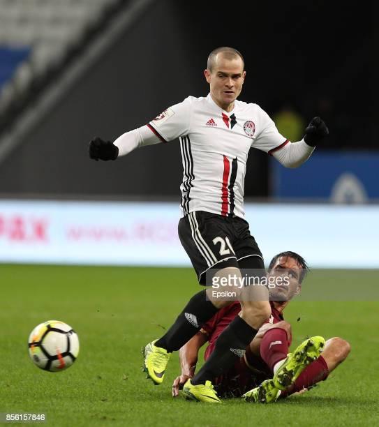 Cesar Navas of FC Rubin Kazan vies for the ball with Vasili Aleynikov FC Amkar Perm during the Russian Premier League match between FC Rubin Kazan...