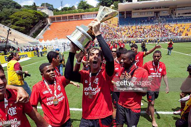 Cesar of Flamengo raises the trophy after the soccer match Flamengo v Bahia as part of the Sao Paulo Juniors Cup 2011 at Pacaembu Stadium on January...