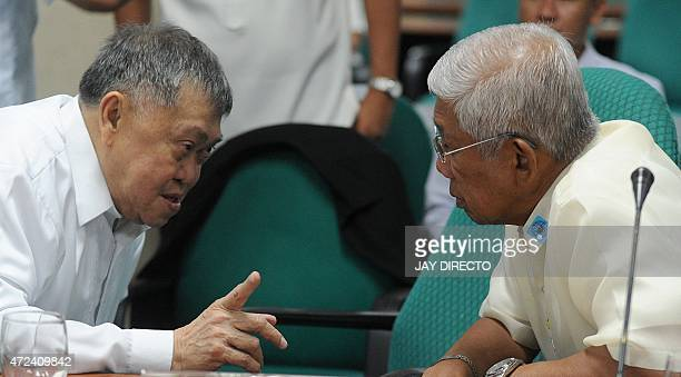 Cesar P Garcia Jr Director General of the National Security Council talks to Voltaire Gazmin Secretary of Department of National Defense during a...