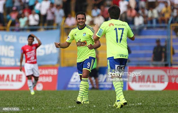 Cesar Pereyra of Sporting Cristal celebrates after scoring the fourth goal of his team against Union Comercio during a match between Union Comercio...