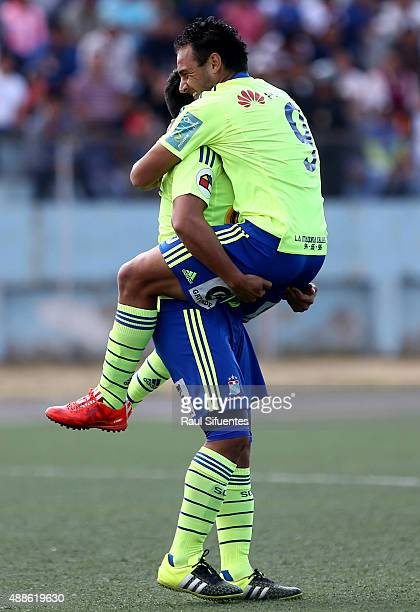 Cesar Pereyra of Sporting Cristal celebrates with his teammate after scoring the first goal of his team against UTC during a match between UTC and...