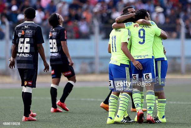 Cesar Pereyra of Sporting Cristal celebrates with his teammates after scoring the first goal of his team against UTC during a match between UTC and...