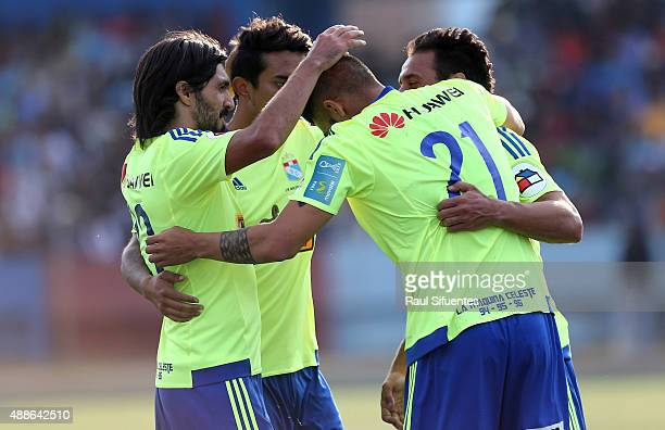 Cesar Pereyra of Sporting Cristal celebrates with his teammates after scoring the third goal of his team against UTC during a match between UTC and...