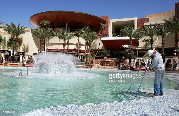 Cesar Pimienta cleans the threeacre Sandbar backyard pool area the centerpiece of the Red Rock Casino April 17 2006 in Las Vegas Nevada The USD 925...