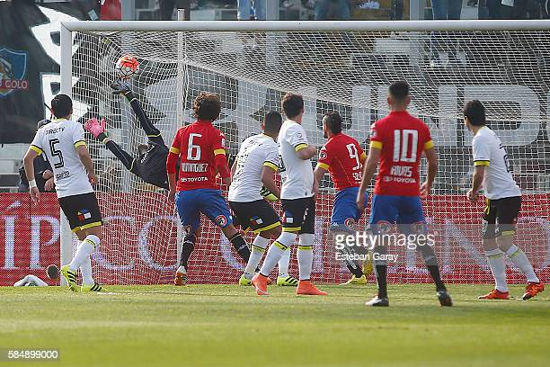 Cesar Pinares of Union Espan–ola scores the first goal of his team during a match between Colo Colo and Union Espa–ola as a part of round 2 of...