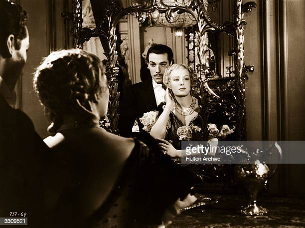 Cesar Romero and Binnie Barnes star in 'Diamond Jim' a film about the life of a millionaire playboy directed by A Edward Sutherland for Universal