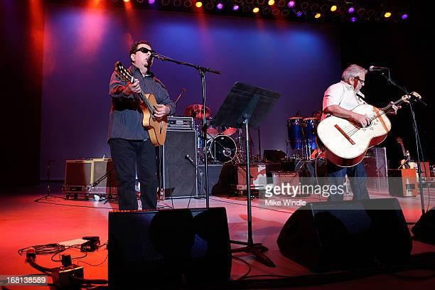 Cesar Rosas and Conrad Lozano of Los Lobos perform on stage during 899 KCRW presents the 2nd annual Los Lobos Cinco De Mayo festival at The Greek...