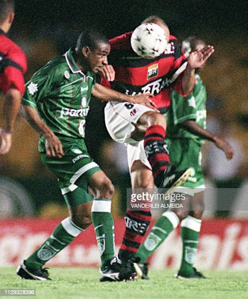 Cesar Sampaio of team Palmeiras fights for the ball with Leandro Avila of team Flamengo 16 December during the first of two games in the final of the...
