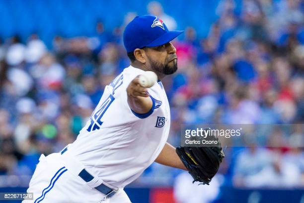 TORONTO ON JULY 25 Cesar Valdez of the Blue Jays delivers a pitch during the 2nd inning of MLB action as the Toronto Blue Jays host the Oakland...