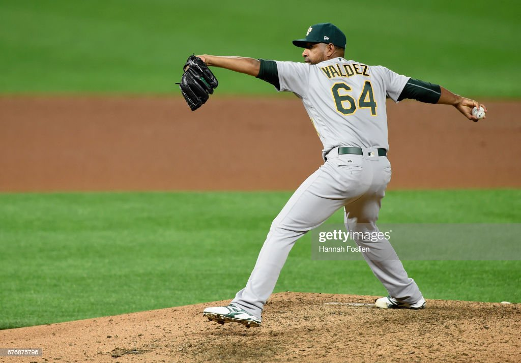 Cesar Valdez #64 of the Oakland Athletics delivers a pitch against the Minnesota Twins during the seventh inning of the game on May 2, 2017 at Target Field in Minneapolis, Minnesota. The Twins defeated the Athletics 9-1.