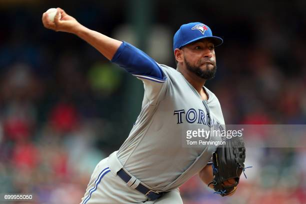 Cesar Valdez of the Toronto Blue Jays pitches against the Texas Rangers in the bottom of the eighth inning at Globe Life Park in Arlington on June 22...