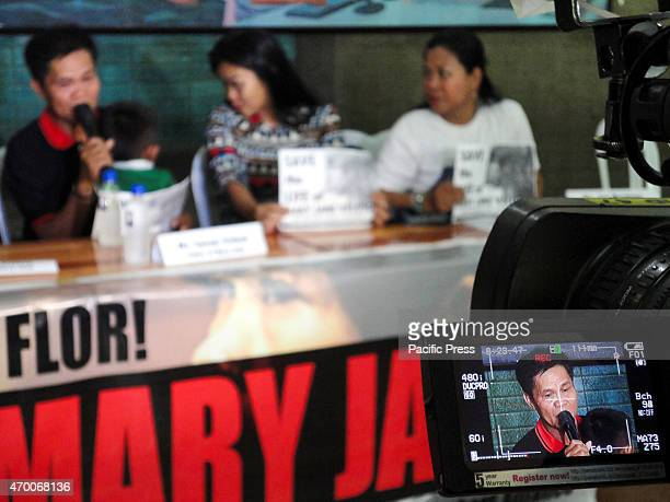 Cesar Veloso father of convicted drug trafficker Mary Jane Veloso is seen through the screen of a video camera as he gives a statement during a press...