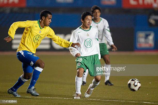 Cesar Villaluz of Mexico struggles for the ball with Simoes of Brasil during in the final of the under17 World Cup at Nacional Stadium on October 02...