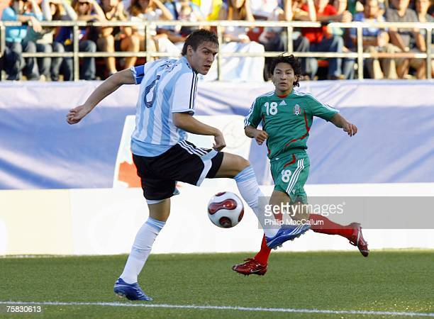 Cesar Villaluz of Mexico watches as Matias Cahais of Argentina plays the ball in the quarterfinal match of the FIFA U20 2007 World Cup at Frank Clair...