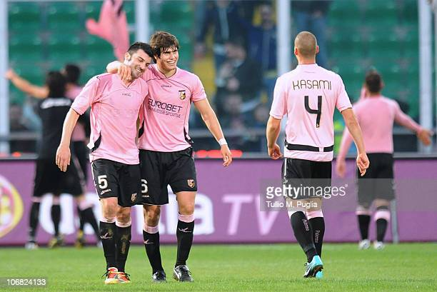 Cesare Bovo and Ezequiel Munoz of Palermo celebrate after winning the Serie A match between Palermo and Catania at Stadio Renzo Barbera on November...