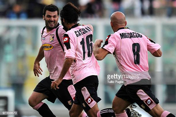Cesare Bovo celebrates with Mattia Cassani and Giulio Migliaccio of Palermo after scoring the winning goal during the Serie A match between US Citta...
