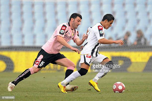 Cesare Bovo of Palermo and Alexis Sanchez of Udinese compete for the ball during the Serie A match between Udinese Calcio and US Citta di Palermo at...
