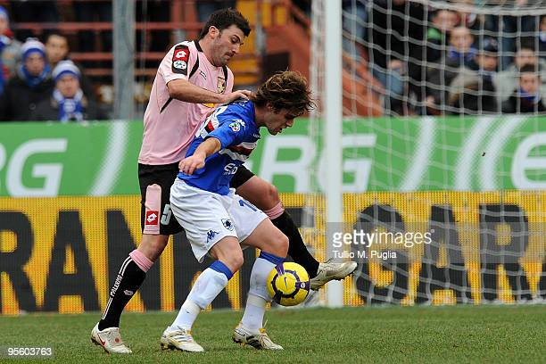 Cesare Bovo of Palermo and Andrea Poli of Sampdoria compete for the ball during the Serie A match between UC Sampdoria and US Citta di Palermo at...
