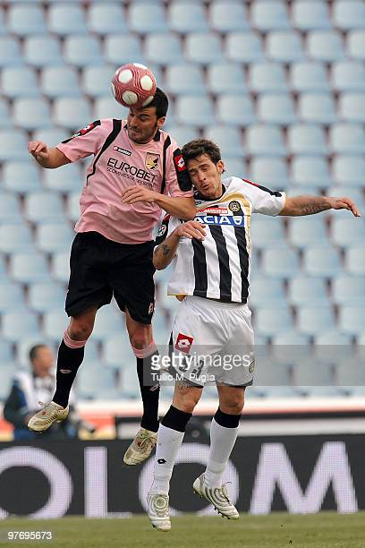 Cesare Bovo of Palermo and Floro Flores of Udinese compete for a header during the Serie A match between Udinese Calcio and US Citta di Palermo at...