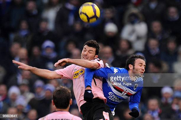 Cesare Bovo of Palermo and Giampaolo Pazzini of Sampdoria compete for a header during the Serie A match between UC Sampdoria and US Citta di Palermo...