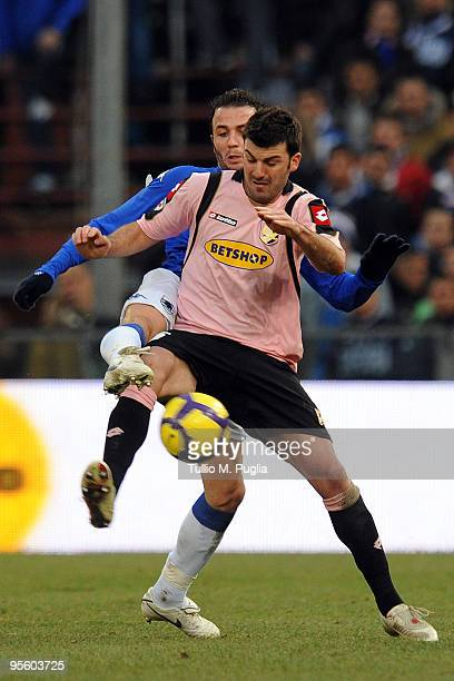 Cesare Bovo of Palermo and Giampaolo Pazzini of Sampdoria compete for the ball during the Serie A match between UC Sampdoria and US Citta di Palermo...