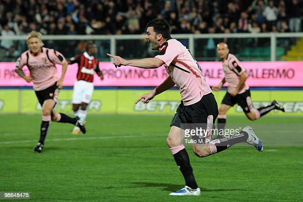 Cesare Bovo of Palermo and his team-mates celebrate the opening goal during the Serie A match between US Citta di Palermo and AC Milan at Stadio...