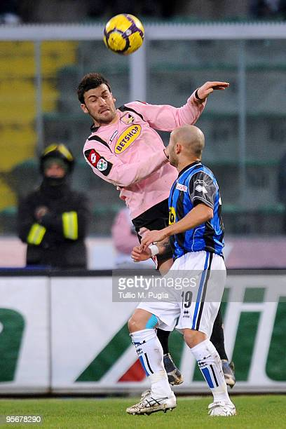 Cesare Bovo of Palermo and Javier Chevanton of Atalanta compete for a header during the Serie A match between US Citta di Palermo and Atalanta BC at...