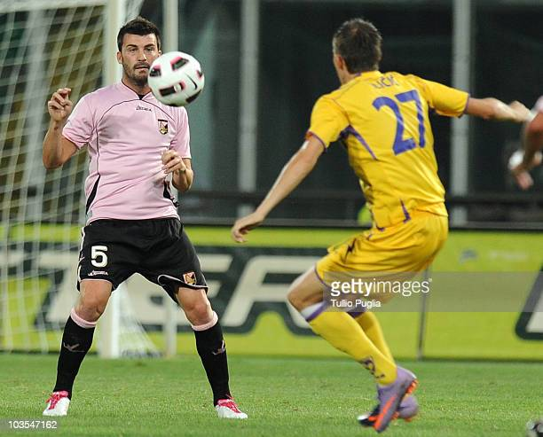 Cesare Bovo of Palermo and Josip Ilicic of Maribor compete for the ball during the UEFA Europa League Play Off first leg match between US Citta di...