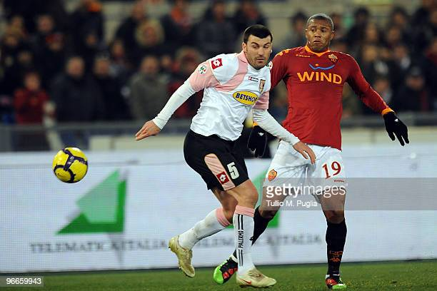Cesare Bovo of Palermo and Julio Baptista of Roma compete for the ball during the Serie A match between AS Roma and US Citta di Palermo at Stadio...