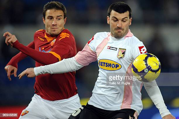 Cesare Bovo of Palermo and Matteo Brighi of Roma compete for the ball during the Serie A match between AS Roma and US Citta di Palermo at Stadio...