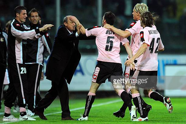 Cesare Bovo of Palermo celebrates with coach Delio Rossi and team mates after scoring the opening goal during the Serie A match between US Citta di...