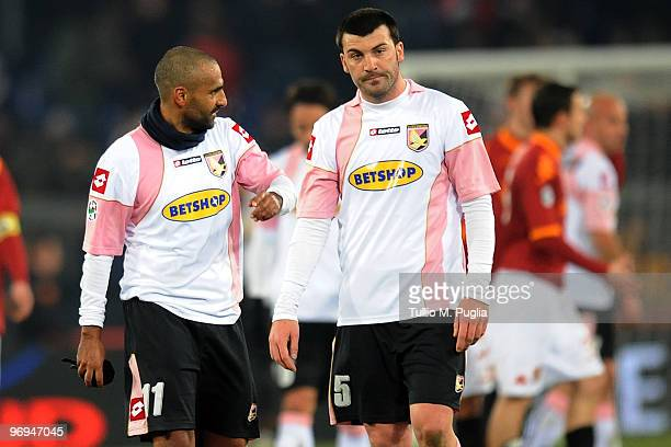 Cesare Bovo of Palermo looks dejected as his team mate Fabio Liverani gestures after loosing the Serie A match between AS Roma and US Citta di...