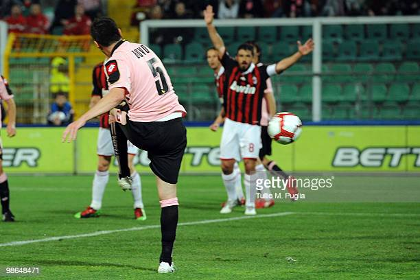 Cesare Bovo of Palermo scores the opening goal during the Serie A match between US Citta di Palermo and AC Milan at Stadio Renzo Barbera on April 24,...