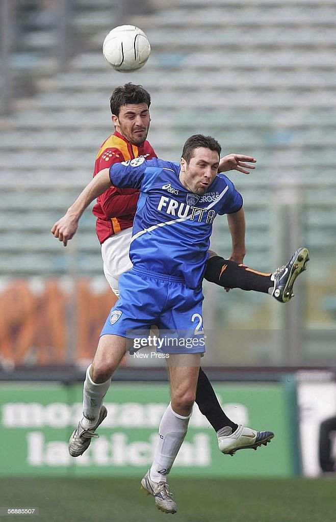 Cesare Bovo of Roma competes with Fabrizio Ficini of Empoli during the Serie A match between AS Roma and Empoli at the Stadio Olimpico on February 19, 2005 in Rome, Italy.
