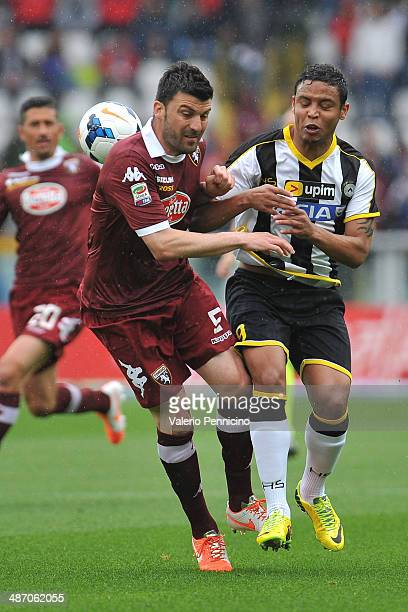 Cesare Bovo of Torino FC clashes with Luis Muriel of Udinese Calcio during the Serie A match between Torino FC and Udinese Calcio at Stadio Olimpico...