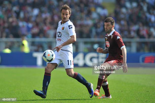 Cesare Bovo of Torino FC competes with Alberto Gilardino of Genoa CFC during the Serie A match between Torino FC and Genoa CFC at Stadio Olimpico di...
