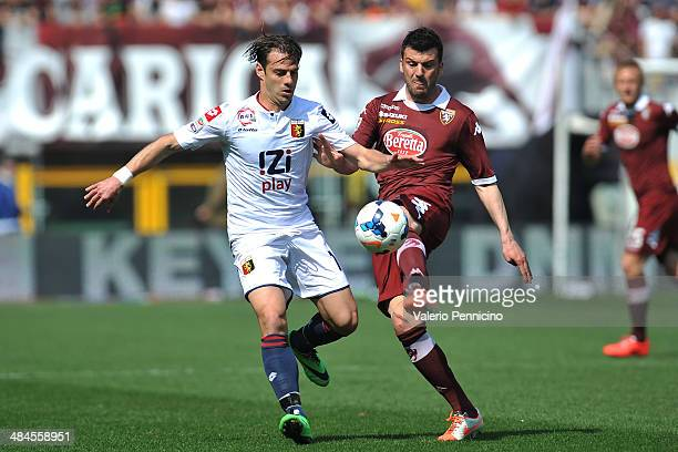 Cesare Bovo of Torino FC competes with Emanuele Calaio of Genoa CFC during the Serie A match between Torino FC and Genoa CFC at Stadio Olimpico di...