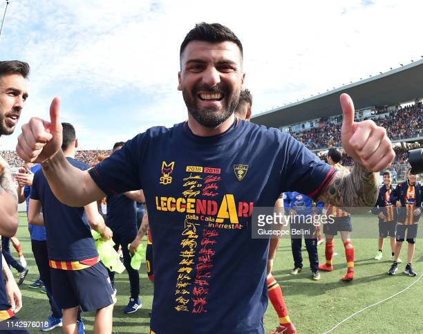 Cesare Bovo of US Lecce celebrates second place in the Serie B championship and promotion in the Serie A championship after the Serie B match between...