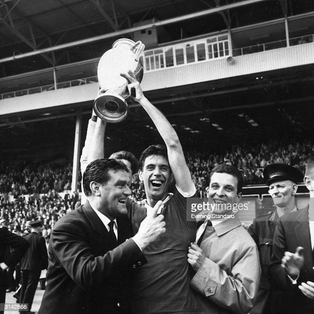 Cesare Maldini the Milan captain holds up the winner's trophy after his team's 21 win against Portugal in the European Cup Final at Wembley