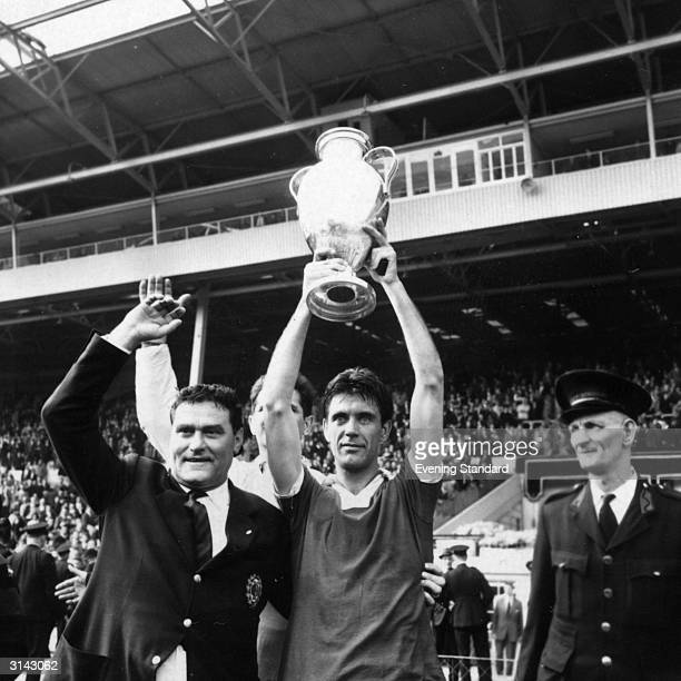 Cesare Maldini the Milan captain holds the European Cup aloft after their win at Wembley beating Portugal 21