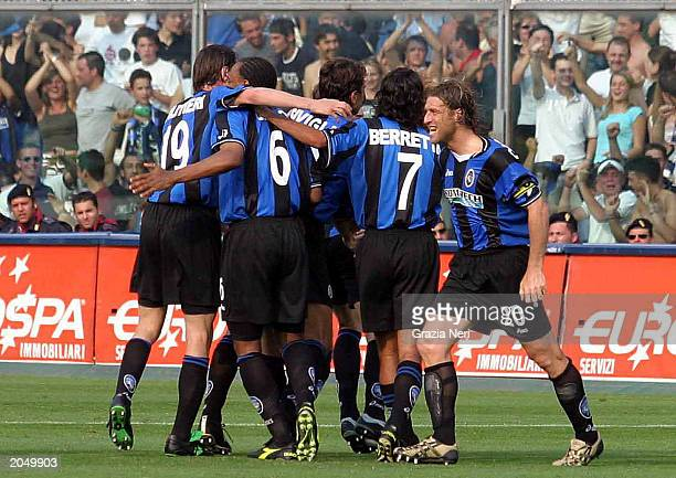 Cesare Natali of Atalanta is congratulated by his teammates after scoring a goal during the second leg of the Serie A relegation playoff match...